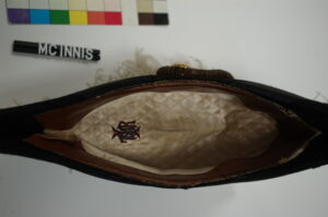 This is a photograph showing the interior of the Lieutenant-Governor uniform hat and the hand embroidered monogram.