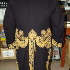 This is a photograph showing the back of the uniform after it had been repaired by museum conservators.