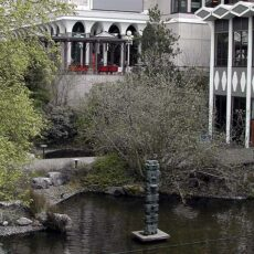 This is a photograph showing the outside of the BC Archives with pond in front.