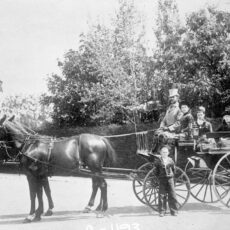 This is a black and white photograph of Clement Cornwall with his family in a horse led carriage.