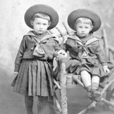 This is a black and white photograph of two boys in 1870.