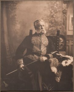 This is a photograph of Edgar Dewdey seated wearing the Lieutenant-Governor uniform.
