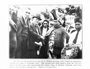 This is a black and white photograph of Walter Nichol shaking hands with Chief Maquinna.