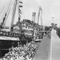 This is a black and white photograph of a ship, the SS Princess Sophia, at dock in Victoria BC and packed with troops bound for war.