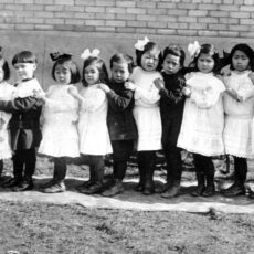 This is a black and white photograph of twelve young children at an orphanage in Victoria in 1913.
