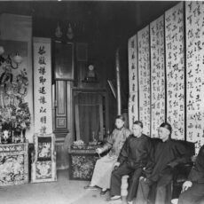 This is a black and white photograph of four men sitting in the interior of a Joss House on Government Street in Victoria BC.