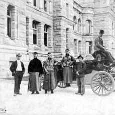 This is a black and white photograph of influential Chinese merchants, including Lim Bang in front of legislative buildings in Victoria BC in 1904.