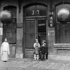 This is a black and white photograph of children outside a building in Victoria's Chinatown in 1900.