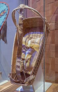 This is a photograph of an Interior Salish First Nations baby basket.