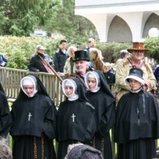 This is a photograph of actors dressed in historical costumes re-enacting the arrival of the Sisters of St Ann to Fort Victoria.