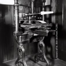This is a black and white photograph of a printing press.