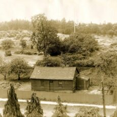 This is a black and white photograph of St Ann's Schoolhouse in about 1932 in its original location.