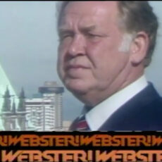 This is an image of a screen grab from BCTV's Webster show, showing Jack Webster in the foreground and the top of a building in the background.