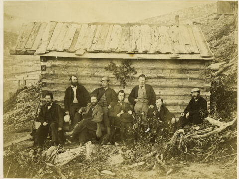 Miners From Heron Claim, Heronville and Governor Seymour Seated Outside Building. 1867.  Frederick Dally, Photographer.