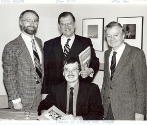 Four gentlemen in suits pose for a photo during National Film Week in Vancouver. From left to right: Archivist Derek Reimer, Provincial Archivist John Bovey, Archivist Dennis Duffy (below), Stanley Fox.