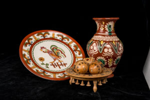 Collection of Ukrainian wood carvings including a plate and vase.
