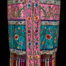 A Chinese parade canopy made of colourful fabric embroidered with flowers.