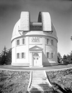 Completed dome with shutters open. Elevated view from south of the Dominion Astrophysical Observatory showing the entire dome, front entrance and steps.