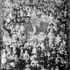 Black-and-white image of hundreds of children and babies collaged onto one image.
