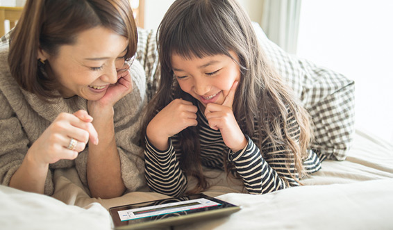 Mother and daughter using the Learning Portal website on a tablet