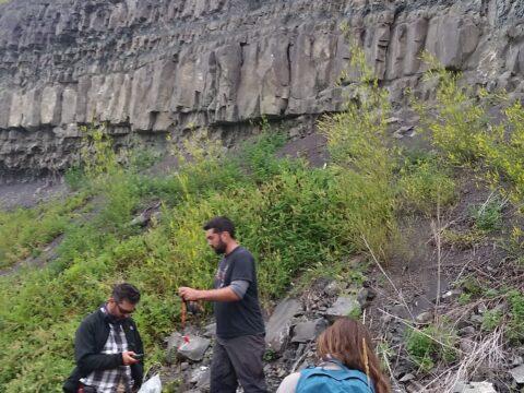 23david tom jade at huge outcrop on railway in rain