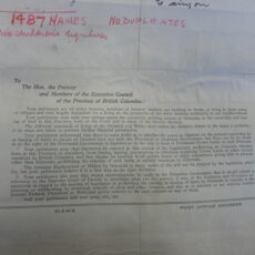 A typed letter is attached to the beginning of the scroll. Above the letter, the number of individuals that signed the petition (1,487) is handwritten in red.